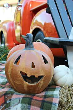 Outdoor Fall Harvest Party Ideas With a Rustic  Style: Pottery jack-o-lanterns, plaid wool blanket, an Adirondack chair and a vintage pick-up create a classic look for this Halloween party. See more of this terrific styling by Kristin Cadwallader of Bliss at Home.... on The Home Depot Blog. || @gwhkristy