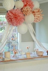 Love how they used the Pom Poms to cover the chandelier and then brought the ribbon down to the sides of the table!