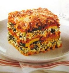 Raise the Roof Sweet Potato Lasagna from the Engine 2 Diet by Rip Esselstyn.  Yummy (contains, soy, corn, wheat noodle, nuts) Omit any and use subs like hummus, GF past and different veggie).