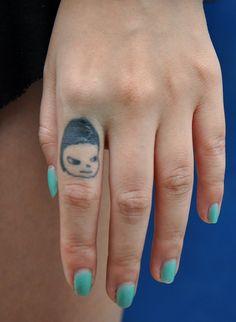 yoshitomo nara finger tattoo