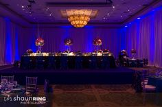 Elevated head table in center of Indian reception ballroom via IndianWeddingSite.com