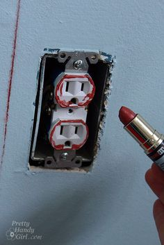 Mark where to cut out on wood paneling & how to install an outlet extender via Pretty Handy Girl