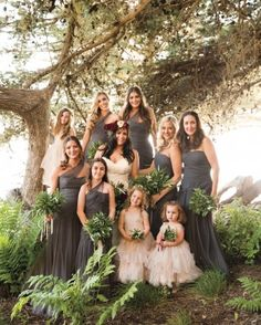 Sarah's bridesmaids wore Monique Lhuillier gowns and clutched fragrant bouquets of rosemary, bay leaves, and olive branches. View the DIY, refined rustic California wedding online.