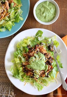 This simple slow cooker chicken taco salad is high in fiber and protein which means it's very satisfying – all for under 300 calories
