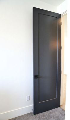 Interior door painted with Sherwin Williams Black Magic