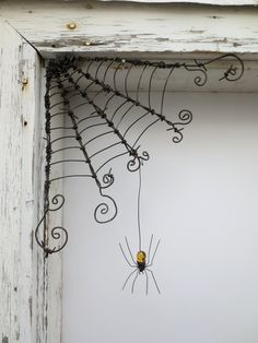 """Czechoslovakian Yellow Spider Dangles From 12""""  Barbed Wire Corner Spider Web. $51.00, via Etsy."""