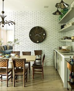 Love this kitchen.  The clock.  The white subway tile with dark grout.