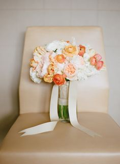 orange wedding bouquet - photo by Laura Ivanova http://ruffledblog.com/spring-minneapolis-wedding