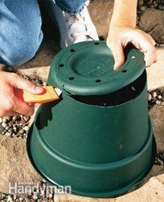 Cut the bottom off a plastic pot or pail and plant invasive plants in the pot to stop them from taking over the garden