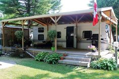 via 13 Canadian Cottage:I've seen this before; someone takes a travel trailer or even a mobile home and builds a roof over it to create a roof/ front & back porch and builds in the 3 sides. It's really very cool!