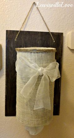 Upcycle and oatmeal container to make a plastic bag holder plastic bags, shopping bags, oatmeal container crafts, diy crafts, crafti stuff, grocery bags, burlap crafts, plastic shop, bag holder