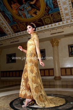 super gold Kebaya fashion with a good trail bordir in a large shape of trail and make this very-very exellent.