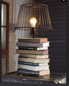 Stacked-Book Lamp.. Perk up Mom's decor (and nod to her bibliophile tendencies) by crafting this industrial-chic upcycled book lamp.