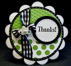Love the colors on this handmade thank you card - green, black and white are great together!  Several sizes of circle punches are combined along with dotted paper and dimensional embossed dots.  The faux stitching and gingham ribbon add some straight lines to an otherwise round card.