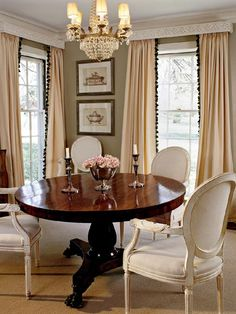 cream dining room with round table