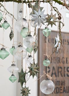Pretty baubles and stars hanging from a branch