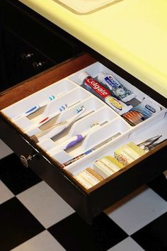 GREAT IDEA ALERT! Organize your bathroom by reusing your old silverware container! (@Sarah Chintomby Chintomby Hull)