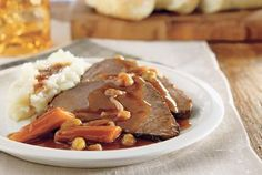 This recipe for All Day German Pot Roast, or sauerbraten, calls for cider vinegar, gingersnap cookies and dry red wine. Brown sugar offsets the bitter taste of the vinegar and wine. Your family will love this traditional German recipe.