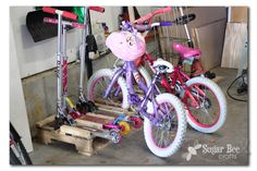 scooter and bike rack from pallets and sugar bee crafts blog  - MY DREAM TRUE!!  Hate those scooters!