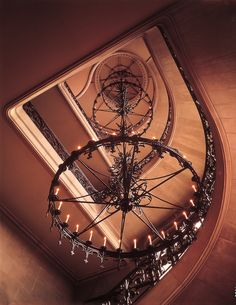 This is the 102-step Grand Staircase which stretches to the fourth floor.  A large, wrought-iron chandelier runs through the center, illuminated by 72 electric bulbs, and suspended from a single point.