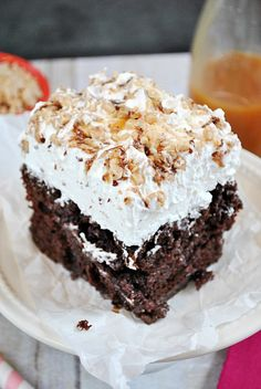 BTS Cake aka Poke Cake aka The BEST Cake you'll ever eat!! This super moist and decadent cake is smothered in whipped cream, Heath Toffee, and caramel sundae sauce   www.somethingswanky.com