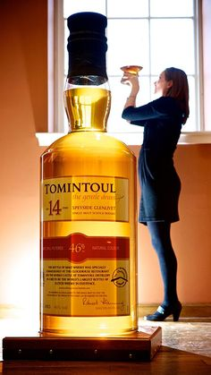 The world's largest bottle of single malt scotch is on loan at the Royal Mile visitor centre until April. It contains the equivalent of 150 standard bottles of whisky. The 4ft 9in bottle is filled with 105.3 litres of Tomintoul 14-year-old Single Malt.