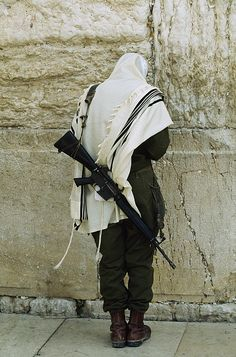 """Israeli Soldier With Rifle Praying"""