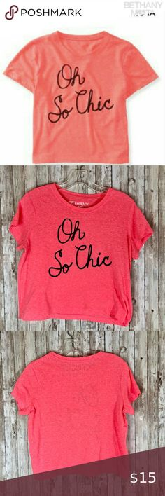"Bethany Mota ""Oh So Chic"" bright coral cropped tee From Aeropostle's colab with Bethany Mota, this longer cropped tee says ""Oh So Chic"" in black letters on a bright, almost neon coral/orange background. Fun with big sunnies and distressed shorts by the pool.  Measurements when laid flat: armpit to armpit: 19"" length: 19"" bottom opening: 19""  70% polyester/30% cotton - wash in cold water Bethany Mota Tops Crop Tops"