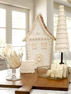 White gingerbread house, cookies & candy canes.