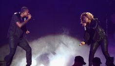 """""""Help"""" is on the way. GRAMMY winners Lecrae and Erica Campbell perform their gospel hit at the 45th Annual GMA Dove Awards at Allen Arena on Oct. 7, 2014 in Nashville, Tenn."""