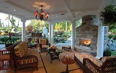 Love this covered outdoor living area from House Plans and More. Cozy!