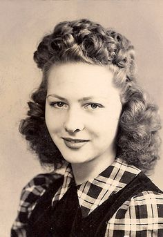 Love her curled bangs and charming plaid blouse. #vintage #woman #beautiful #1940s #forties #hair #fashion #clothes #style