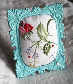 Very sweet idea! Framed pincushion using a vintage embroidered doily or handkerchief.