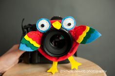 Lens Bling for your camera to capture the attention of your little one. Easy to make with a hair scrunchie, colored felt, googly eyes and a few stiches.