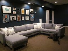 Ikea Karlstad sectional with art wall above  our little urban Life: basement reveal