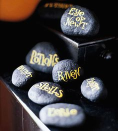 """Witching Words  """"Sprinkle a handful of spellbinding stones on a tabletop to make guests stop and ponder. Use acrylic paints to blacken stones, then hand write or stencil seasonal words or phrases on the tops"""""""