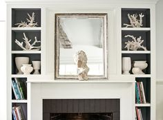 dark gray inside cabinets, white collection of ceramics & coral