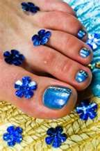 toes painted a blue that takes me back to Hawaii