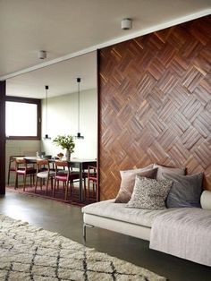 Square wood panels fashioned into a mosaic-style wall  Love the wall - parquet flooring...who knew?
