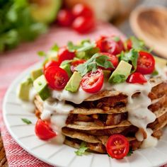 Cheesy Chicken Enchilada & Tortilla Stacks are made with chewy corn tortillas stacked with enchilada chicken.