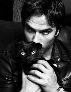 Guys with cats are always cute.