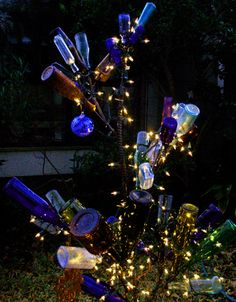 Bottle Trees with lights - like it!