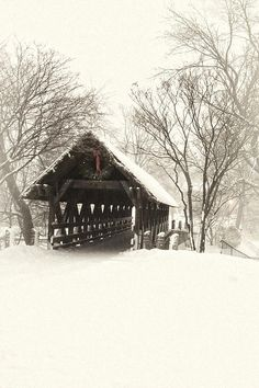 Snow in covered bridge with Christmas decorations