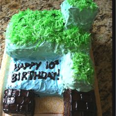 Avery's MineCraft bday cake! Green colored coconut for grass, Nutella as frosting for the brown blocks. I used 1 white cake in a loaf pan, 1 swirl cake in z loaf pan and a chocolate 8x8 cake to make this.