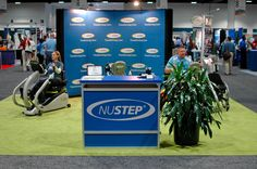 Janet Craig welcomes visitors to the NUSTEP demonstration booth.