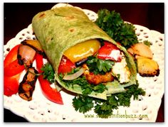 Chicken kebab grilled veggie wrap with tahini paste