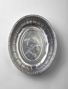 embossed portraits on aluminum pans
