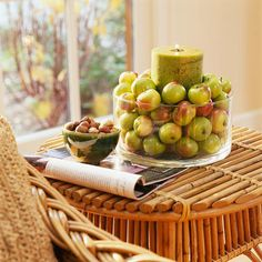 """""""Stocky candle in middle of a glass salad or punch bowl and fill with green apples."""" You can elevate a short candle and hide with apples. - @bhg"""