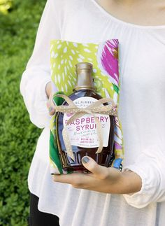 Next time you need a hostess gift, hit the food aisle at HomeGoods! A unique treat like this raspberry syrup tied with a tea towel makes the perfect gift! (sponsored pin)