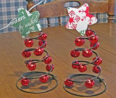 DIY: Jingle Bell Christmas Trees.....made with springs from an old chair cushion and red jingle bells!